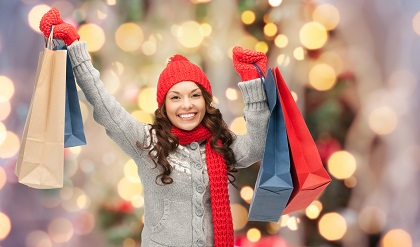 holidays, x-mas, sale and people concept - happy young asian wom